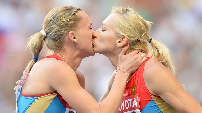 588370-russian-athletes-039-kiss-provokes-debate