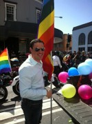 Rob Cavallucci was the lead flag bearer at Brisbane Pride Festival in 2013