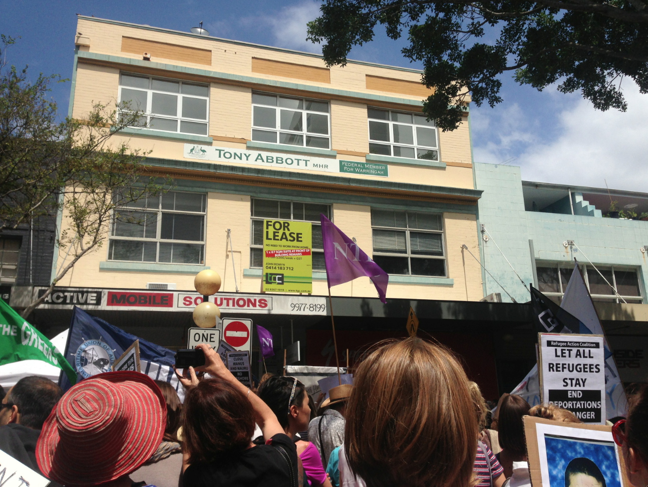 Refugee protest outside Tony Abbott Manly office after Reza Berati death
