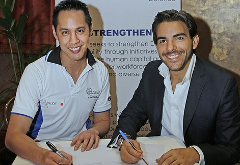 Vince Chong, President of DEFGLIS, signs agreements with Emmanuel Giuffre, Secretary of SGLBA. PHOTO: Ann-Marie Calilhanna