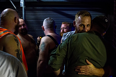 Contestants and their partners hug before going on stage for round 3. (Photo: Bodie Strain; Star Observer)
