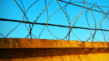 wire fence asylum seekers refugees prison jail gaol