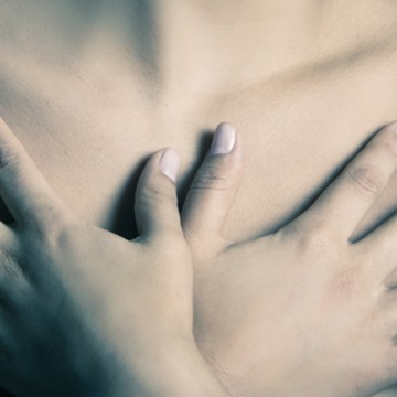 mothers breasts woman hands chest