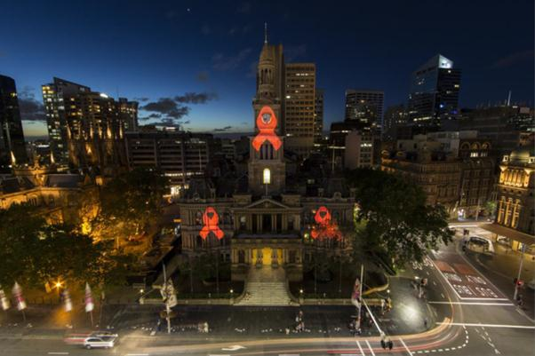 Red ribbon projection on Sydney Town Hall for World AIDS Day