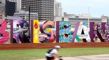 (Image source: ABC News -- http://www.abc.net.au/news/2014-10-31/a-cyclist-rides-past-a-brisbane-sign/5856298)
