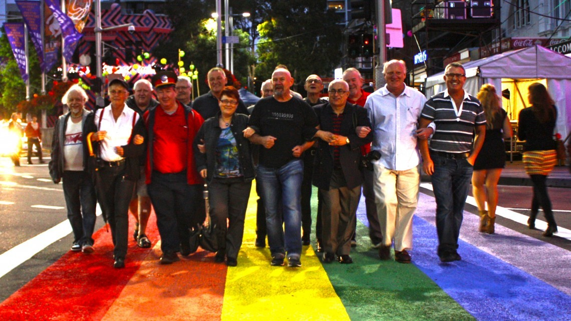 A group of 78ers walk across the rainbow crossing at Taylor Square. (Photo: Steve McLaren)