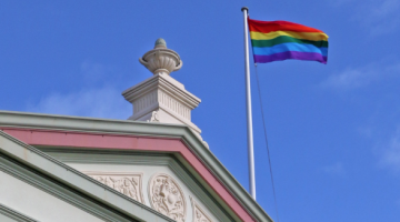 The rainbow flag flying atop Randwick Town Hall to celebrate Mardi Gras season (PHOTO: Benedict Brook; Star Observer)