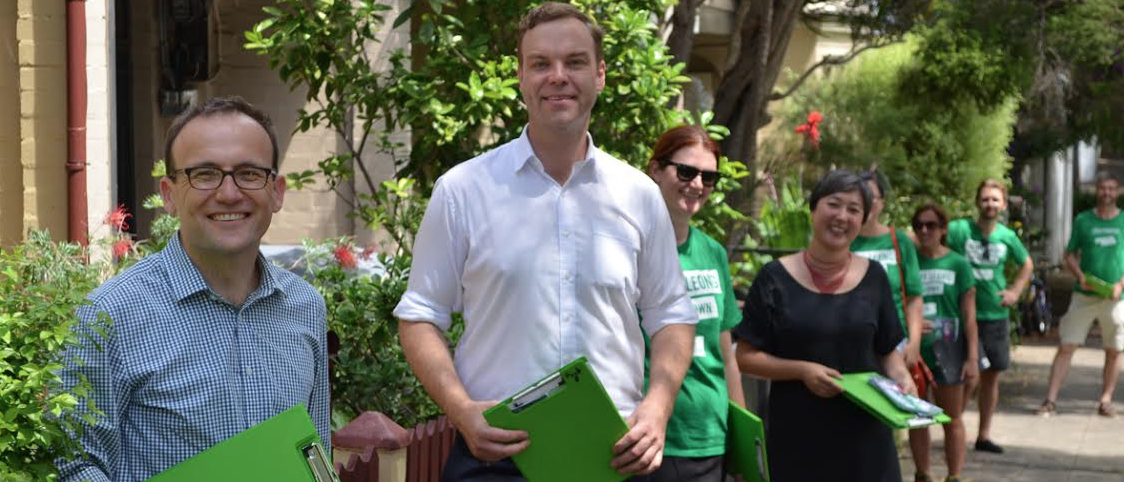Melbourne federal Greens MP Adam Bandt (front) door knocking around Sydney's Camperdown with a team of NSW Greens supporters, Leichhardt state Greens MP Jamie Parker (white shirt) and Greens candidate for Newtown Jenny Leong (in black). PHOTO: Benedict Brook; Star Observer