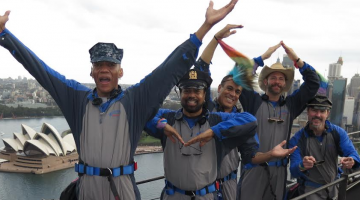 The Village People perform the YMCA on top of the Sydney Harbour Bridge as part of the Mardi Gras Disco Climb for Sydney Gay and Lesbian Mardi Gras. (Supplied photo)