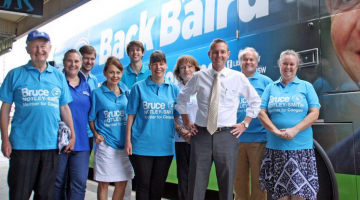 Coogee state Liberal MP Bruce Notley-Smith (in white shirt) on the campaign trail in his electorate. (Image source: Twitter)