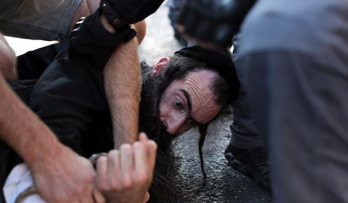 The suspect is arrested shortly after he stormed the Jerusalem Gay Pride marchers.