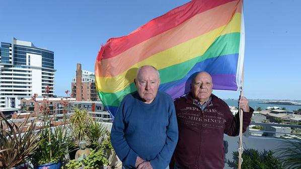Murray Sheldrick, 78, and James Bellia, 72, were ordered to take down their rainbow flag from their Port Melbourne apartment balcony. (Image via Twitter)