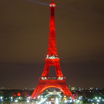 The Eiffel Tower in Paris, France lights up red for World AIDS Day. (PHOTO: Zedwarf/Flickr)