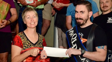 Ann Matson and Mr Queensland Leather David Eisentraut handing over the cheque. (PHOTO: David Alexander; Star Observer)