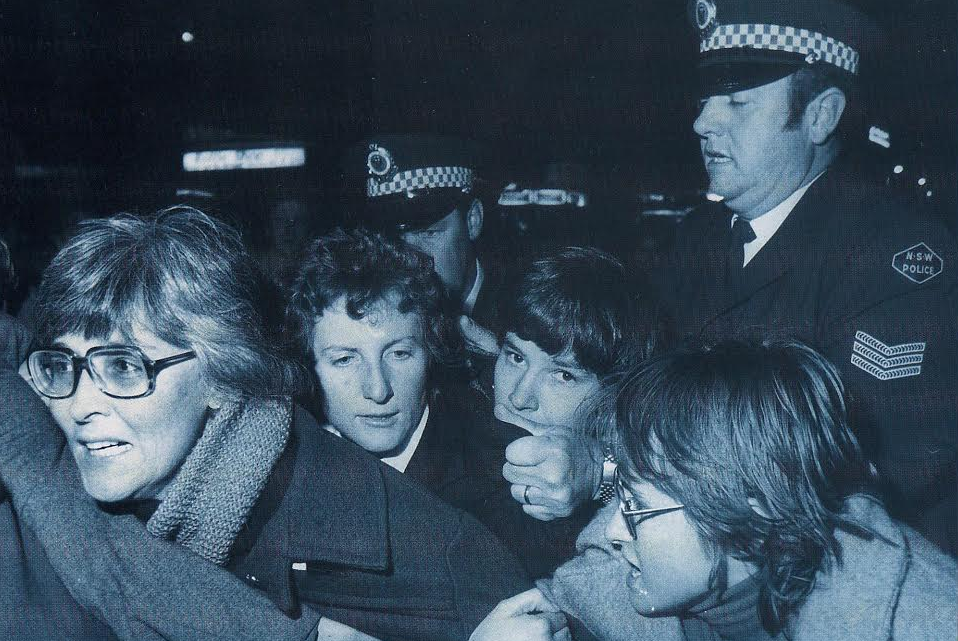 Gail Hewison (far left) just seconds before arrest at the first Mardi Gras in 1978. She said the police officer behind grabbed her by her hair and dragged her across the road and tossed her head first into paddy wagon. (Image supplied by Gail Hewison)