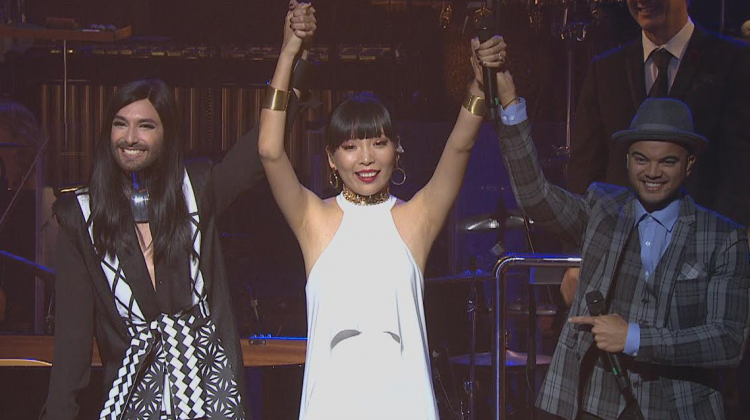 Dami Im (centre) when she was announced at Australia's representative for the 2016 Eurovision Song Contest in Stockholm, Sweden last night at the Sydney Opera House. Pictured with Eurovision 2014 winner Conchita Wurst (left) and Australian Eurovision 2015 contestant Guy Sebastian (right).