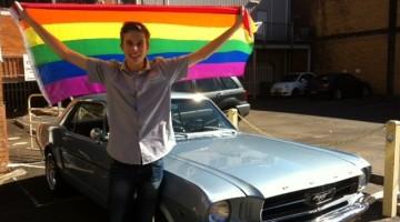 Sam Bouzanquet with a rainbow flag. Photo: Supplied