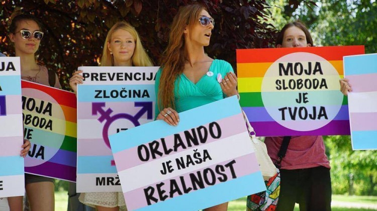 Attendees hold signs during the pride march in Serbia. Picture: Marko Savic