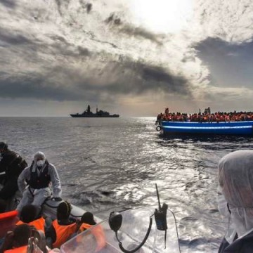 Italy's navy helps a refugee boat in the Mediterranean. Picture: UNHCR