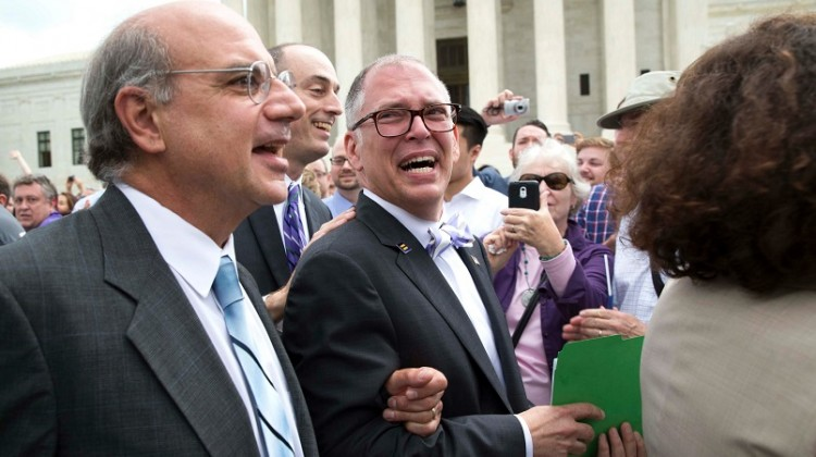 James Obergefell, center, plaintiff in the same-sex marriage case Obergefell v. Hodges before the Supreme Court, walks out of the Supreme Court following the ruling, Friday, June 26,  2015.  ( by Doug Mills/ The New York Times),                                NYTCREDIT: Doug Mills/The New York Times