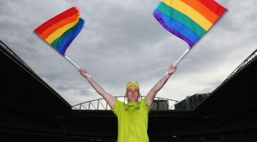 MELBOURNE, AUSTRALIA - AUGUST 09:  AFL Goal umpire Michael Craig waves the Pride Game rainbow goal umpire flag during an AFL media opportunity at Etihad Stadium on August 9, 2016 in Melbourne, Australia. St.Kilda Saints will play Sydney Swans in the Pride Game on the weekend.  (Photo by Michael Dodge/Getty Images/AFL Media)