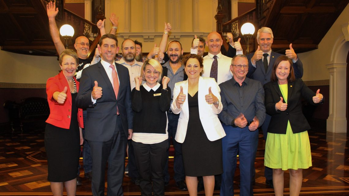 Queensland Labor MPs and members of LGBTI community celebrate the changes to the age of consent laws in the State Parliament. Photo: Supplied
