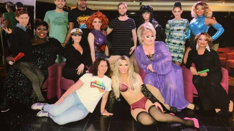 The author and her friends posing with the queens on the latest instalment of the Drag Stars at Sea cruise. Photo: Supplied